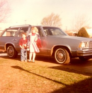 Me and my sister hanging out in front of the car that we both ended up learning to drive.